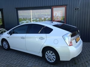 Toyota Prius wit blindering ramen